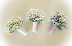 Romantic Baby's breath bouquets in pretty pastels. Designed by Amour Flowers