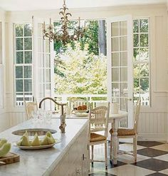 White kitchen with painted floor