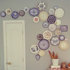 Check out this really unique, fun, creative wall display using artsy glass plates! I love this! What a fun idea! This is my friend's mother's house and she posted this on her Facebook wall. Her friend from TheBlackPumpkin blog came over to her mom's and started hanging these up without a pattern...