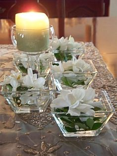 Pretty and simple.....floating gardenias and candles.