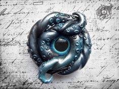Blue and silver polymer clay Kraken brooch by The Arkana Workshop.    In his house at Rlyeh, dead Cthulhu waits dreaming ~ H.P. Lovecraft
