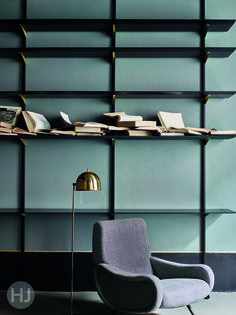 The modular shelving system is designed by Dimore Studio. Home Journal, March 2015