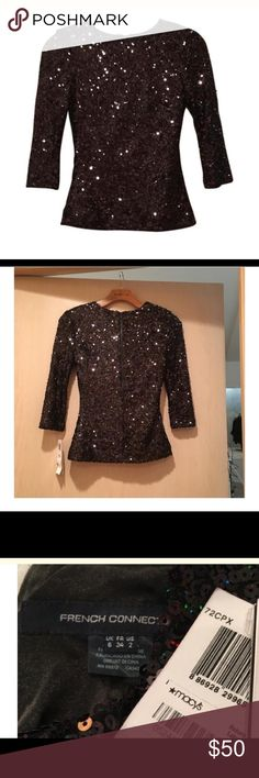 "French connection sequin top Super cool !! Black sequin with back zip . Fully lined . 22"" from shoulder to hem . Wear casual with jeans or dress up with a skirt . Has stretch for a great fit ! French Connection Tops Blouses"