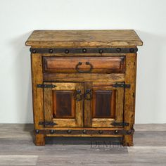 The Old Wood AlamoSpanish style nightstands are built from oldwood. With singledrawer, two-door cabinet, raised paneling, and iron pulls and hardware