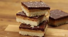 Put the candy bar to shame with this easy-to-make pan of homemade shortbread with layers of caramel and chocolate and a salty finish.  While the shortbread is baking, make the caramel with butter, brown sugar, sweetened condensed milk, and syrup and then spread it over the shortbread.  The chocolate