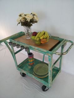 stunning 50's industrial cart with a combination of vintage ivory paint and contemporary turquoise...