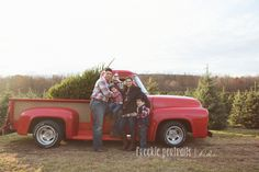 family portrait with christmas tree at the farm