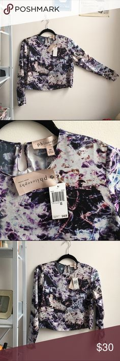 GALAXY NWT Philosophy Crop Top Girl, you're about to DAZZLE in this beautifully patterned galaxy-esque crop top from Philosophy - perfect for your fave high-waisted black pants or skirt for a killer night out - small silver buttons at the end of sleeve and at the nape of the neck. Pictures hardly SO this beauty justice  100% polyester Philosophy Tops Crop Tops