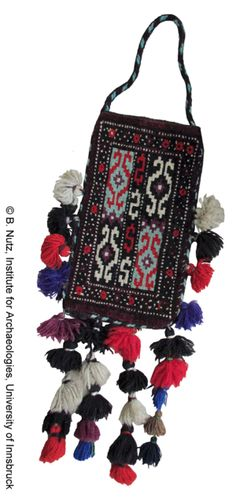 """Yomut spindle bag (igsyalyk or igsalik) from Turkmenistan (one of a pair). 8.62""""-14.96"""", 20th century."""