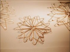 Zip ties hold the 14 hangers in place and the glitter made them look classy and polished! I used hangers I already had, so this cost be O. Diy Christmas Snowflakes, Christmas Window Decorations, Snowflake Craft, 3d Snowflakes, Snowflake Decorations, Kids Hangers, Plastic Hangers, Clothes Hangers, Baby Hangers