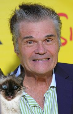 Actor Fred Willard and Siamese friend.  What a cute kitty!