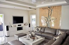Simlpe modern living room with leather couch/sofa and white coffee table. By: Abakon sp. z o.o. spółka komandytowa