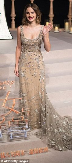 Off with her cape: Emma Watson wore a nude embellished fairytale gown as she joined Dan St...
