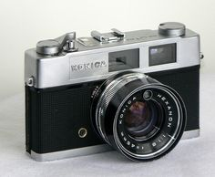 "Konica Auto S2 , 1965, sold retail for $100.00, Lot of money for a kid back then. Their slogan was"" the lens alone is worth the price"". I owned a used one in the early ""80s. The lens was good, but after owning Leicas the Konica was just not in the same league!"