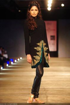 Former Miss India Parvathy Omanakuttan walks the ramp for designer Monisha Jaising on Day 2 of Delhi Couture Week, held in New Delhi, on August 01, 2013.