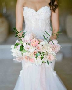 Ideas for Your Spring Wedding Bouquet | Martha Stewart Weddings - Peach-hued roses were mixed with pinker flowers, like astilbe and peonies, in this wedding bouquet. #springflowers #weddingflowers #weddingideas