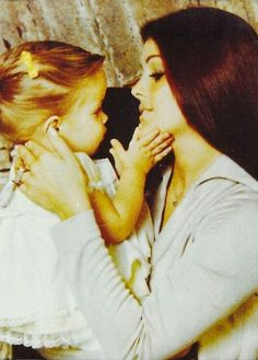 Priscilla and Lisa Marie Presley...A Famous Wife & A Famous Daughter...Until the Music Stopped...Then, Two Gals Having, Thankfully Sucessfully, To Find Their Way In Life...What A Beautiful Shot!!