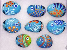 Painted rock fish. Its painted on a beach pebble with acrylic paints and coated with a glossy clear varnish. The back side is left unfinished so you can