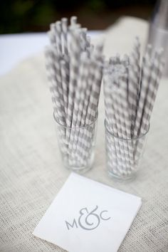 Grey striped straws. Monogrammed napkins. Designed by the bride. Photography by rachelbrooksblog.com, Floral Design   Styling by tulipdesignstudio.com