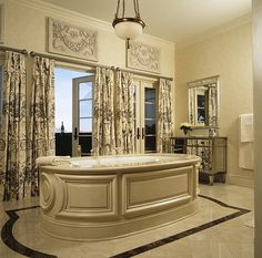 Master bath with a balcony overlooking the city. The tub millwork was quite a challenge. Interior Design by Gary Inman