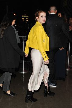 Once the big event is over, hems go higher, thigh-high boots come out, and gowns get swapped for pants | Emma Roberts