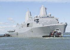 Sailors and Marines man the rails aboard the amphibious transport dock USS Arlington (LPD 24).