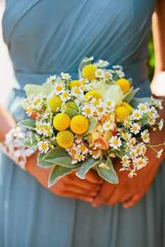 A bridesmaid bouquet with chamomile | Brides.com