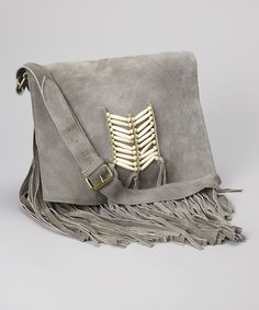 Flaunt carefree fashion and tote essential gear with this boho-chic messenger bag. Exuberant fringe, beaded details and genuine leather combine to create a free-spirited look and a quality accessory. 12.5'' W x 11'' H x 2'' D21'' shoulder dropLeatherThree interior slip pockets