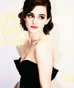 Emma Watson-amazing smoky make up and great hairstyle, supplemented with black dress and fine jewerly simply whole amazing outfit :)