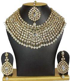 Dazzling Indian Bollywood Gold Plated Bridal White Stone ... https://www.amazon.com/dp/B01MTCB6KI/ref=cm_sw_r_pi_dp_x_KveJyb7H896WP