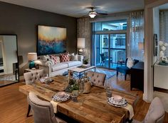 Gorgeous model apartment featuring wood-style flooring in entries, living rooms, kitchens and baths, and dramatic 10-foot and higher ceilings at AMLI RidgeGate, luxury apartments in Lone Tree.