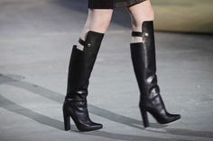 It was hard to beat the models at Alexander Wang's show — Gisele, Frankie, Shalom — but the shoes, which were leather and rigid, like Wang's shoes often are, included this up-to-the-knee boot that brings to mind mud flaps as much as riding chaps.