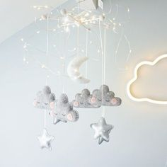 Velveteen Babies • A cloud nursery essential- our mobile with sleepy clouds, moon and silver stars. Makes a nursery magical. Grey, silver and white. Velveteenbabies.co.uk