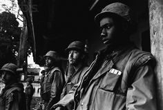 https://flic.kr/p/fZhB7T | Hue 1968 - US soldiers outside a command post in the South Vietnamese city of Hue. | South Vietnam - Image by © Hulton-Deutsch Collection/CORBIS
