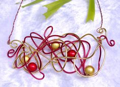 Red and Gold illusion beads twisted with Red asnd Gold alliminium wire stunner statement necklace Christmas Day $39.95 I Love Jewelry, Illusions, Washer Necklace, Tropical, Wire, Jewellery, Beads, Christmas, Gold