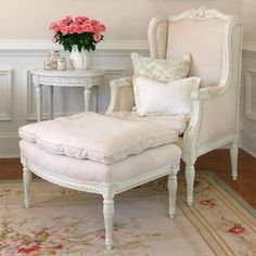 The kind of refined, timeless chair and ottoman that begs you to curl up with your favourite Jane Austen novel for hours on end. #furniture #home #decor #chair #shabby #chic #antique