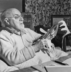 Henri Matisse making paper cuts.