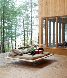 For this communal vacation house outside of Toronto, laidback spaces are a must. On the central covered porch, two-year-old Annika and fi...