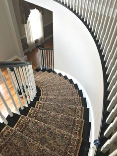 LRV and Benjamin Moore Collingwood Gray, warm gray , greige paint colour. Online Color Consultation by Kylie M Interiors. 2 storey entryway, curved stairs, black railing