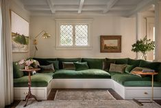 """Lush Luxe: An """"Ode to the Pacific Northwest"""" in a Portland Craftsman - Remodelis. - Lush Luxe: An """"Ode to the Pacific Northwest"""" in a Portland Craftsman – Remodelista - U Couch, Gebogenes Sofa, Sofas, Built In Sofa, Curved Sofa, Street House, Interior Architecture, Luxury Interior, Family Room"""
