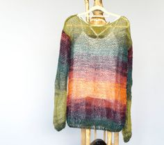 Orange and teal sweater, loose knit top ; hand knit bohemian sweater made airy knit,very light,sheer and still warm.Gradient color (teal,forest green,purple and orange) grunge sweater is perfect for casual and everyday usage, made loose fit,will go perfect with jeans and may combine easily with many colors.  Material : mohair,wool and acrylic mixed yarn.  **Please message me your heigth and weigth during check out ; then I can make the perfect fit!**  **I am using a self gradient mohair…