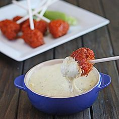 Crispy and juicy Buffalo chicken lollipops with blue cheese fondue. They are perfect for game day!