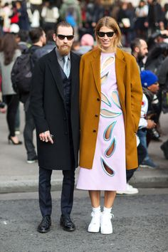 "Justin O'Shea and Veronika Heilbrunner in Christopher Kane calf length dress with big, open ""cut-outs"". Paris Fashion Week, Street style."