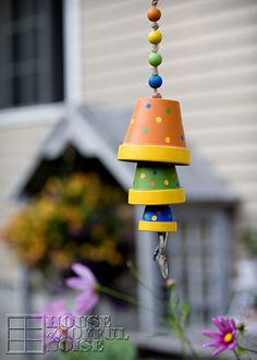 How to make a terracotta flower pot wind chime. http://houseofjoyfulnoise.com/terracotta-flower-pot-wind-chime-tutorial/    terracotta-flower-pot-wind-chime-craft. #crafts, #kidscrafts, DIY