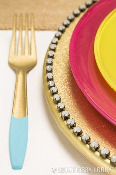 Add some spunk and sparkle to place settings with a sprinkling of glitter, paint and jewels. To make the charger, spray a bare wood plate with glitter, and adhere opal cup chain to perimeter. To make the utensils, dip gold plastic forks in baby blue paint at ends, as shown.