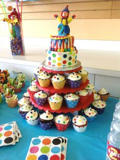 """Gymbo the Clown polka dot carnival birthday cake and cupcake tower. The cupcake stand is the """"party in a box"""" from cupcake tree."""