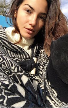 Who made Lily Aldridge's black print cape, white sweater, and thigh high boots?