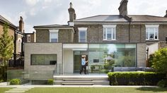 Spanning the full width of the Victorian-era house, the addition creates a new…