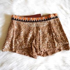 FREE PEOPLE Shorts Embroidered Bohemian Sequin Size XS. New with tags.  $198 Retail + Tax.  Sequined shorts with geometric embroidered waistband and side zip closure.  Lined inner. By Eternal Sunshine Creations for Free People.    Rayon. Sequin embellishment.  Imported.      ❗️ No trades or holds.   💰 Bundle 2+ items for a 20% discount!   👠 Browse through my closet for even more items from this brand!   ✔️ Items are priced to sell, however reasonable offers will be considered when…