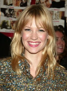 Amid a slew of British actors like Hugh Grant and Emma Thompson, American actress January Jones made an appearance in the 2003 film Love Actually. At the New York premiere, January showed off her signature blond hair with natural waves and bangs, and her makeup was natural with rosy cheeks and a pink pout.